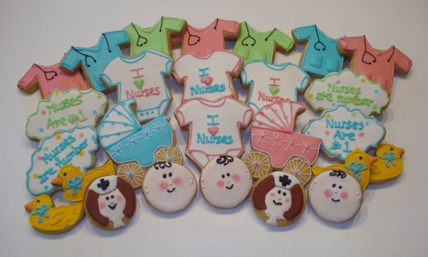 Nurses new baby duck pram decorated cookies